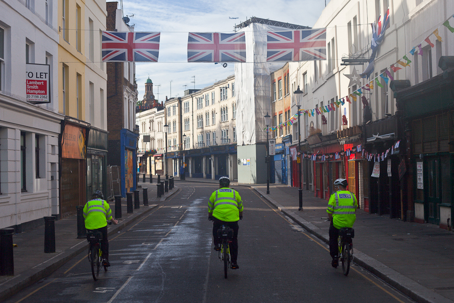 Sometimes its good to get up early. This was taken at The Notting Hill carnival early in the morning before the crowds arrived. I was photographing the flags above the road when the three Policemen came along on their bikes. Sometimes you get lucky!